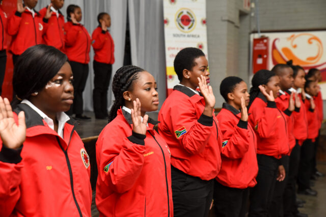 Service leaders in red jackets taking the City Year pledge
