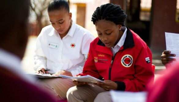 Two City Year South Africa service leaders reading