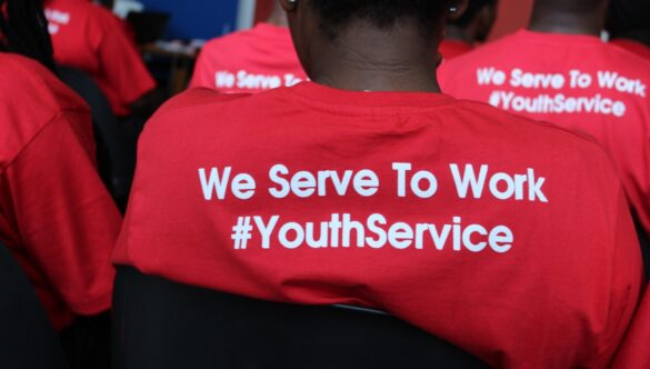 Back of a service leader t-shirt that says: We Serve To Work #YouthService