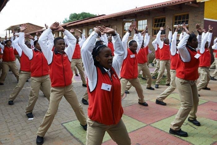 City Year South Africa service leaders doing jumping jacks during PT (physical training)