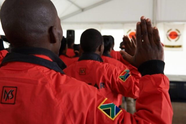 City Year South Africa service leaders in red jackets with hands up for the pledge